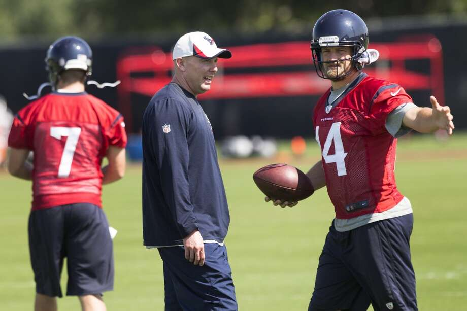 Day 3 - May 29  Texans quarterbacks coach George Godsey, left, works with Ryan Fitzpatrick (14). Photo: Brett Coomer, Houston Chronicle