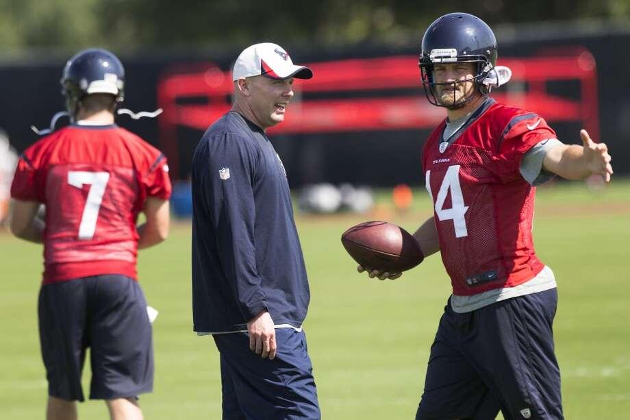 Day 3 - May 29  Texans quarterbacks coach George Godsey, left, works with Ryan Fitzpatrick (14). Photo: Brett Coomer, Houston Chronicle