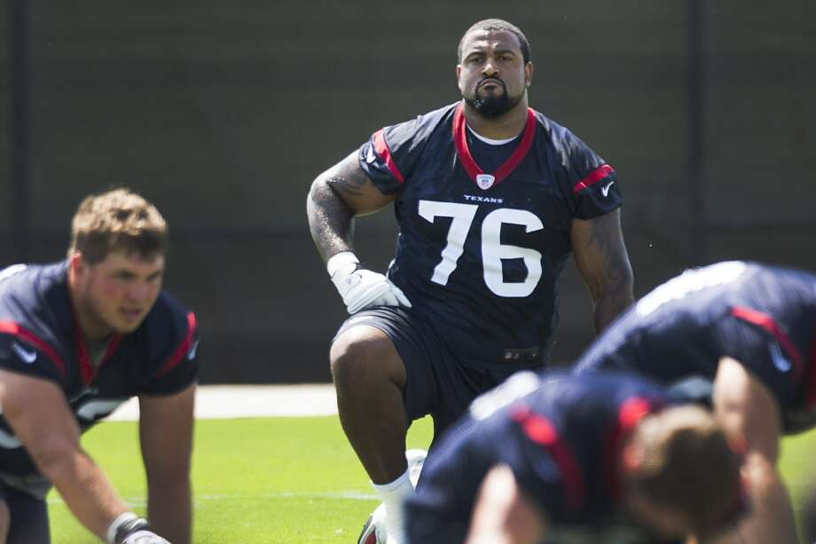 Texans tackle Duane Brown (76) stretches. Photo: Brett Coomer, Houston Chronicle