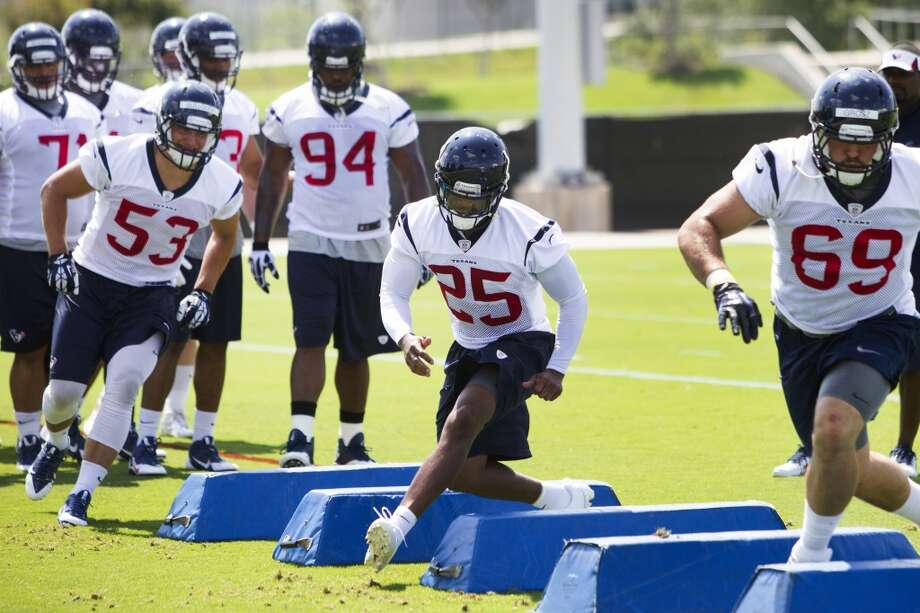 Texans linebacker Max Bullough (53), cornerback Kareem Jackson (25) and defensive end Sullivan Grosz (69) run a drill. Photo: Brett Coomer, Houston Chronicle