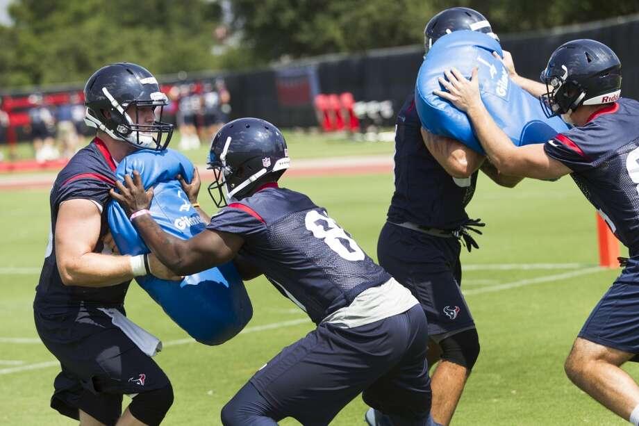 Texans tight ends Chris Coyle, left, and Anthony Denham (81) work on blocking drills. Photo: Brett Coomer, Houston Chronicle