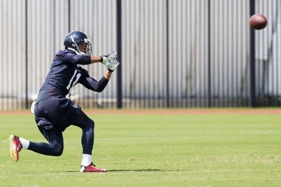 Texans wide receiver DeVier Posey reaches out to catch a pass. Photo: Brett Coomer, Houston Chronicle