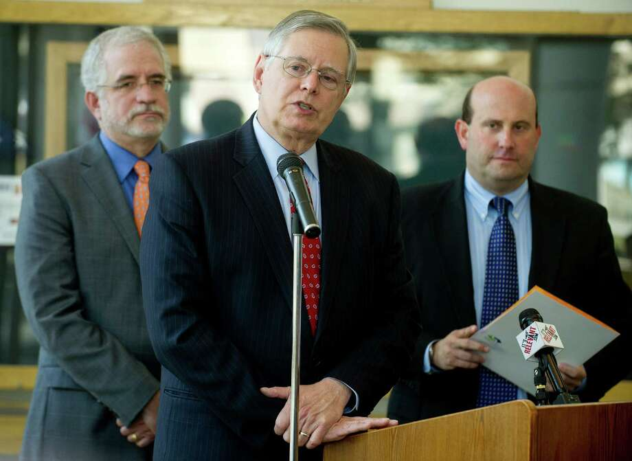 From left, Board of Representatives President Randy Skigen, Stamford Mayor David Martin, and Board of Education President Geoff Alswanger announce the city's purchase of 200 Strawberry Hill Ave. during a press conference at Government Center on Thursday, May 29, 2014. Photo: Lindsay Perry / Stamford Advocate