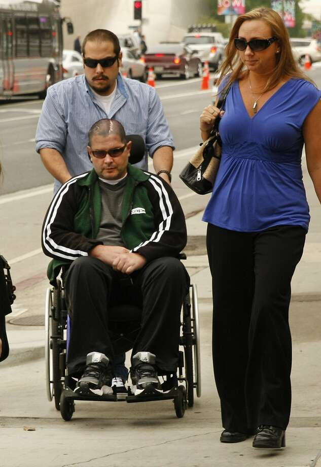 A wheelchair-bound Bryan Stow, assisted by a caregiver, is joined by family members as he enters the Los Angeles County Superior Courthouse on Wednesday, May 28, 2014, as jury selection continued into a second day for the trial of Bryan Stow's lawsuit against former Los Angeles Dodgers owner Frank McCourt and three team entities he created. (Al Seib/Los Angeles Times/MCT) Photo: Al Seib, McClatchy-Tribune News Service