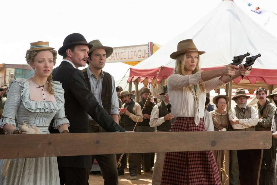 "Louise (Amand Seyfried, from left), Foy (Neil Patrick Harris), Albert (Seth Mac Farlane) and Anna (Charlize Theron) in ""A Million Ways to Die in the West,"" the new comedy from director, producer and co-writer MacFarlane, who plays a formerly cowardly sheep farmer who must put his newfound courage to the test. (Courtesy Lorey Sebastian/MCT) Photo: HANDOUT, McClatchy-Tribune News Service / MCT"