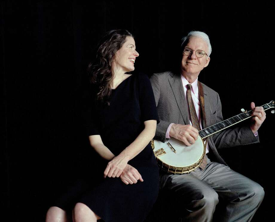 "Steve Martin and Edie Brickell at Town Hall in New York, March 4, 2013. Martin and Brickell collaborated on an album of bluegrass-tinged contemporary songs, ""Love Has Come For You,"" to be released on April 23, 2013. (Fred R. Conrad/The New York Times) -- PHOTO MOVED IN ADVANCE AND NOT FOR USE - ONLINE OR IN PRINT - BEFORE APRIL 21, 2013. Photo: FRED R. CONRAD / NYTNS"