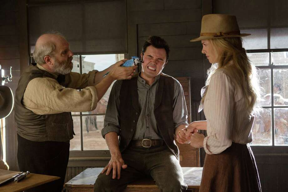 "This image released by Universal Pictures shows, from left, Jay Patterson, Seth MacFarlane and Charlize Theron in a scene from ""A Million Ways to Die in the West."" (AP Photo/Universal Pictures) ORG XMIT: NYET306 Photo: Lorey Sebastian / Universal Pictures"