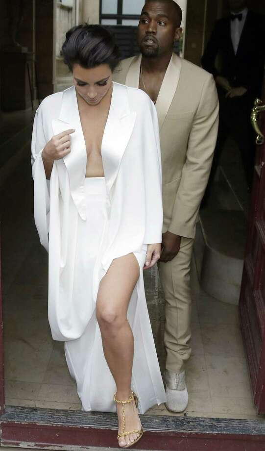 Glamour without substance:  Kim Kardashian and Kanye West leave their  Paris residence before their wedding. Photo: Kenzo Tribouillard / AFP / Getty Images / AFP