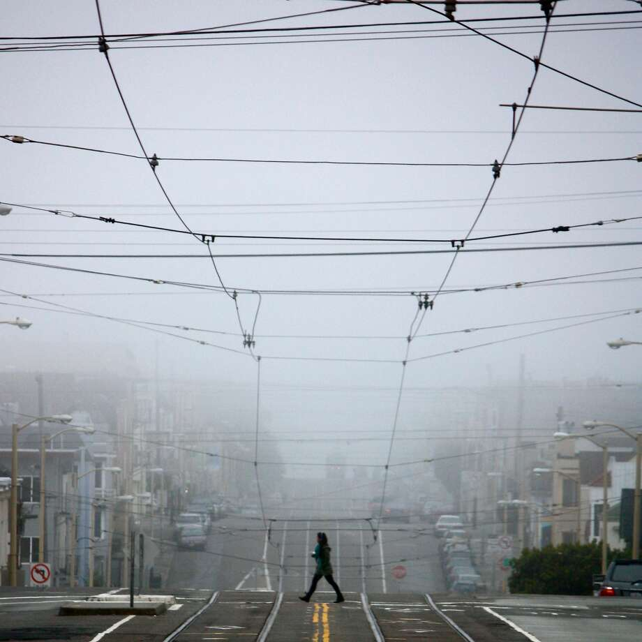 "Photographer Kevin Kelleher shot this perfectly composed image in the foggy Central Sunset District at 22nd Ave. and Judah. One of his inspirations is his father Tim, also a photographer, who introduced his son to the concepts of composition and use of available light. ""The City itself is a constant muse full of diversity and culture. As a street and portrait photographer, I have at least two cameras that are ready to catch these moments."" Follow Kevin on Instagram @KevinKelleherPhotography and if you would like to have your image of San Francisco considered for publication, post it to Instagram with the tag #howsfseessf. We will contact you if your photograph is chosen. Photo: Kevin Kelleher, Special To The Chronicle"
