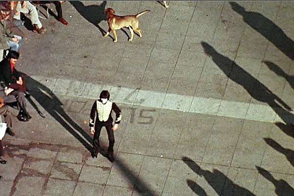 """A mine (portrayed by Robert Shields) performs in the afternoon shadows of Union Square, as part of  Francis Ford Coppola's 1974 film, """"The Conversation,"""" which was filmed in San Francisco."""