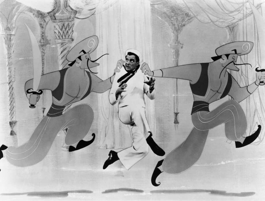 American singer and actor Gene Kelly in a scene from the live action/animated 'Sinbad The Sailor' section of the MGM musical 'Invitation To The Dance', 1956. Kelly also directed and choreographed the film. Photo: Pictorial Parade, Getty / 2009 Getty Images