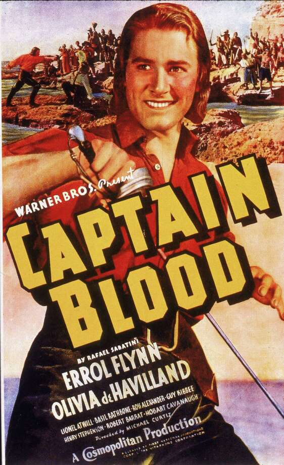Promotional poster for the adventure film 'Captain Blood,' directed by Hungarian-born director Michael Curtiz and released in 1935. Featured prominently in the poster is actor Errol Flynn as Dr. Peter Blood, who is dressed in a pirate's costume and wields a sword. Photo: Hulton Archive, Getty / 2005 Getty Images