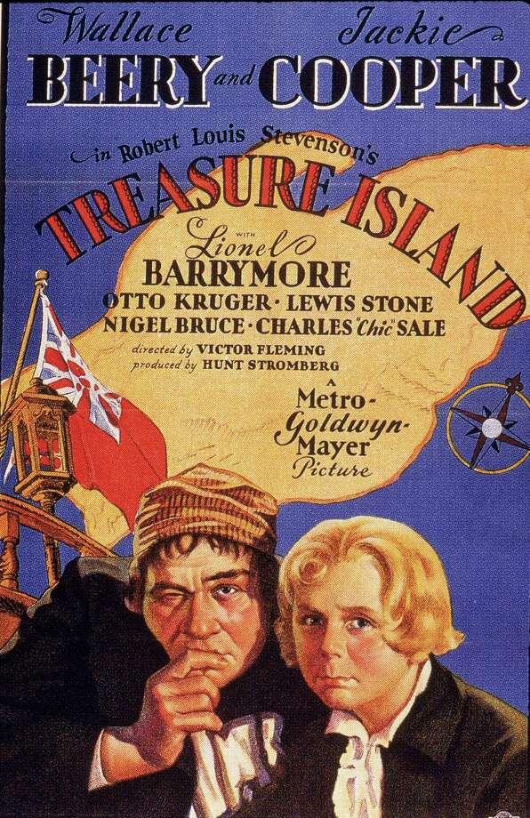Promotional poster for the adventure film 'Treasure Island,' directed by American director Victor Fleming (1889 - 1949) and released in 1934. The poster features American actors Wallace Beery (1885 - 1949) (as Long John Silver) and Jackie Cooper (as Jim Hawkins) in costume. Photo: Hulton Archive, Getty / 2005 Getty Images