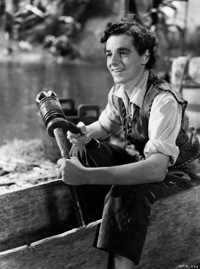 Freddie Bartholomew the stage name of Frederick Llewellyn, the British child actor who found fame in Hollywood is getting to grips with woodwork in a scene from 'Swiss Family Robinson' 1940. Studio: RKO, Gene Town. Director: Edward Ludwig. Photo: Hulton Archive, Getty / Moviepix