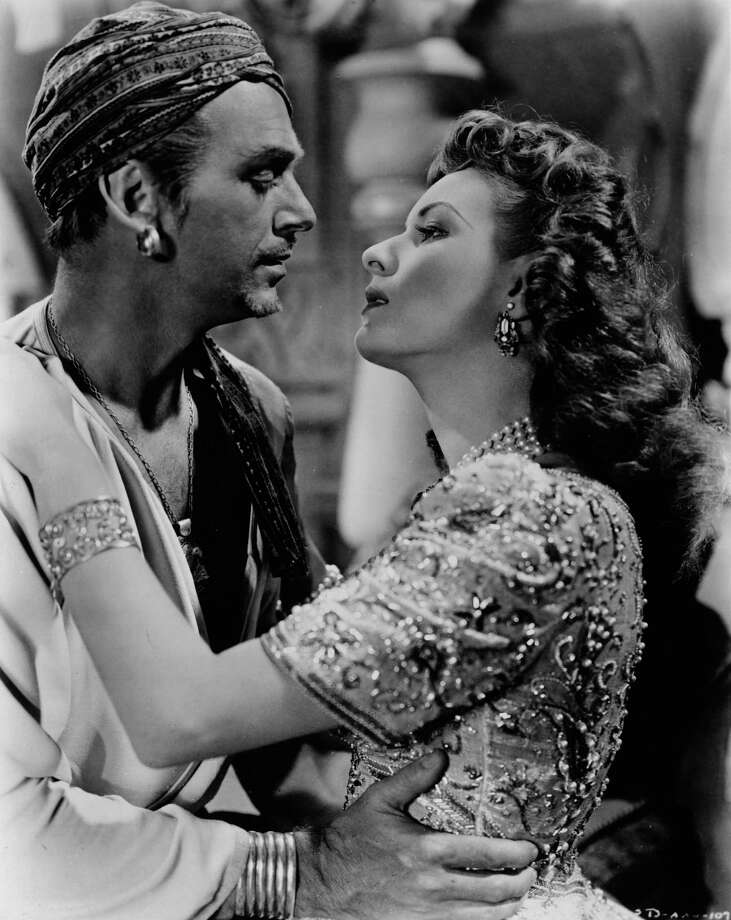 Maureen O'Hara finds Douglas Fairbanks Junior hard to resist in RKO's production of 'Sinbad the Sailor', 1947. Photo: Hulton Archive, Getty / Hulton Archive