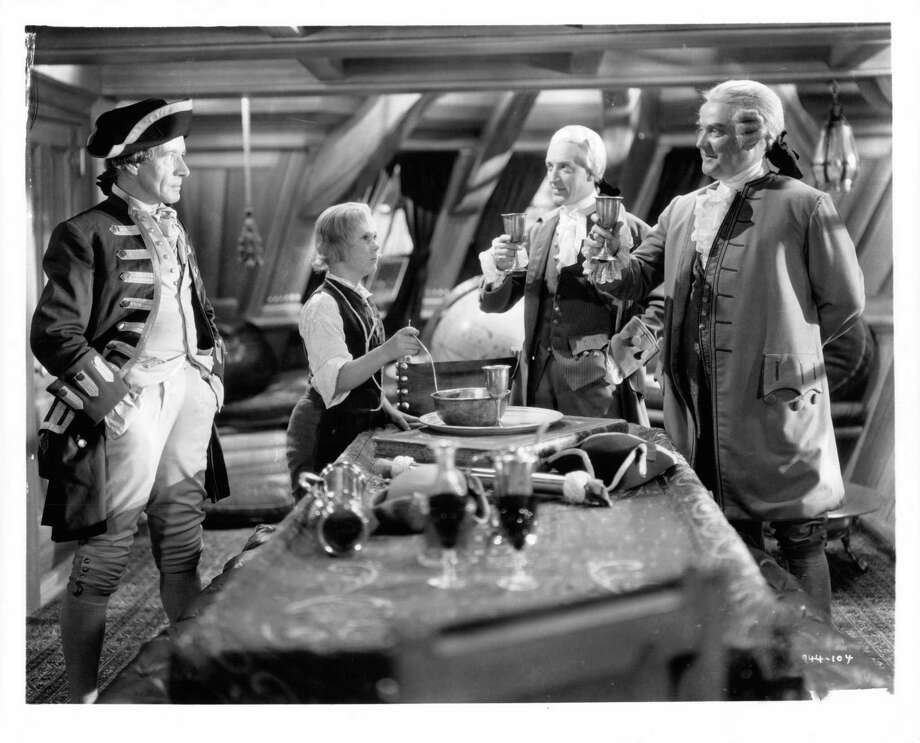 Jackie Cooper serving drinks in a scene from the film 'Treasure Island', 1934. Photo: Archive Photos, Getty / 2012 Getty Images