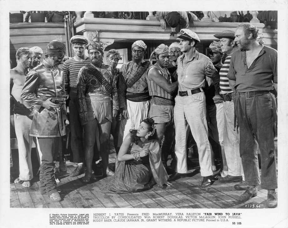 Vera Ralston and Fred MacMurray surrounded by unidentified men in a scene from the film 'Fair Wind To Java', 1953. Photo: Archive Photos, Getty / 2012 Getty Images