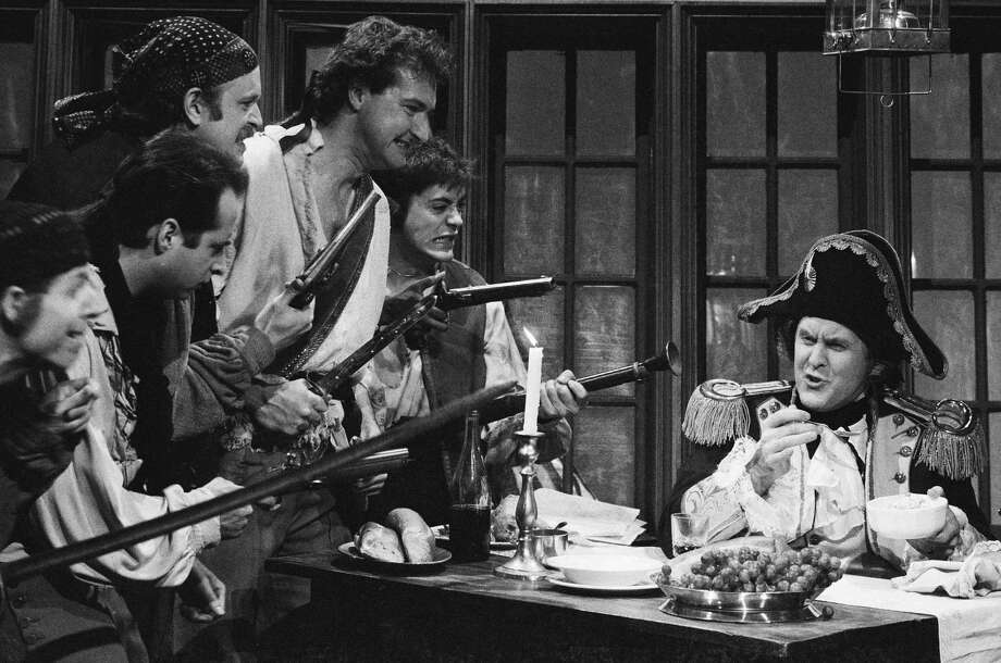 "Saturday Night Live, originally aired December 7, 1985. From left to right, Terry Sweeney as Jones, sailor, Jon Lovitz as Jenkins, sailor, Unknown, Randy Quaid as sailor, Robert Downey Jr. as Jim Grier, sailor, John Lithgow as captain during ""Mutiny On The U.S.S. Cameron""Photo by: Alan Singer/NBCU Photo Bank Photo: NBC, Getty / © NBC Universal, Inc."