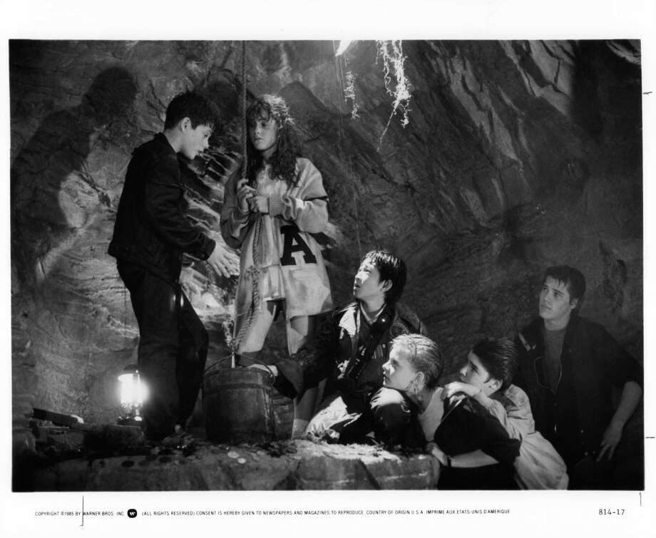 Sean Astin And Kerri Green with others talk in a cave in a scene from the film 'Goonies', 1985. Also pictured are Ke Huy Quan, Martha Plimpton, Corey Feldman and Josh Brolin. Photo: Michael Ochs Archives, Getty / 2011 Getty Images