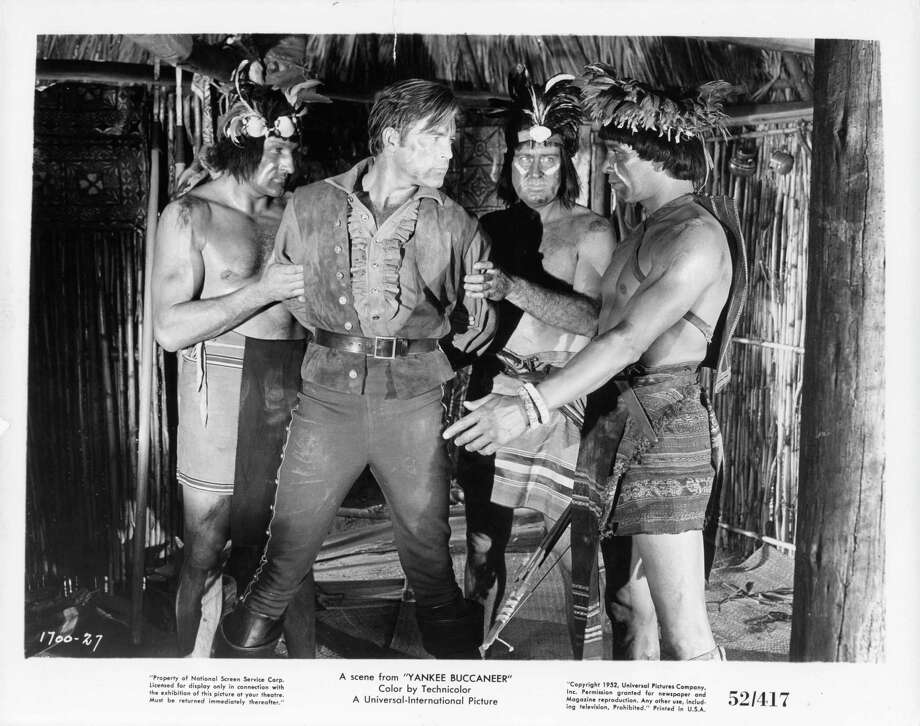 Scott Brady is captured by natives in a scene from the film 'Yankee Buccaneer', 1952. Photo: Archive Photos, Getty / 2012 Getty Images