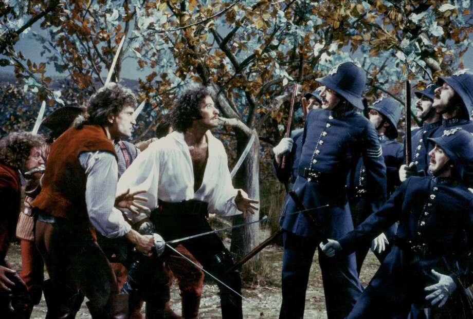 Actors Kevin Kline, Rex Smith and Tony Azito in a fight scene from the film 'The Pirates of Penzance', based on the Gilbert and Sullivan operetta, 1983. Photo: Stanley Bielecki Movie Collection, Getty / 2013 Getty Images