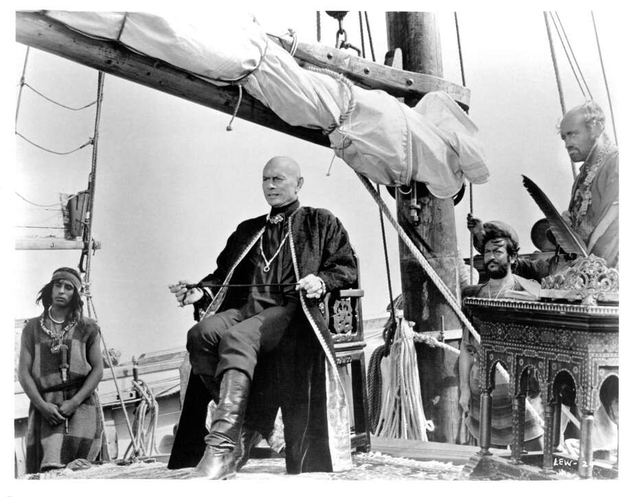 Yul Brynner sits at the head of his ship in a scene from the film 'The Light At The Edge Of The World', 1971. Photo: Michael Ochs Archives, Getty / 2013 Getty Images