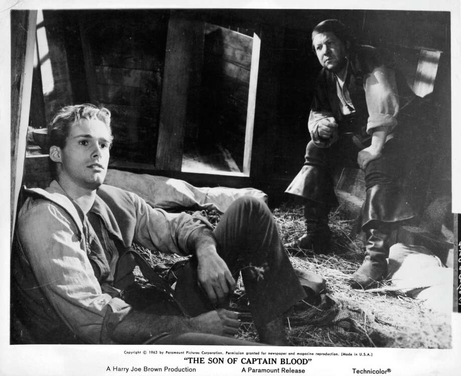 Sean Flynn sits in hay with another man in a scene from the film 'The Son Of Captain Blood', 1962. Photo: Archive Photos, Getty / 2012 Getty Images
