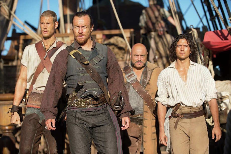 "Billy Bones (Tom Hopper), Captain Flint (Toby Stephens), Gates (Mark Ryan), John Silver (Luke Arnold) in, ""Black Sails."" (2014) Photo: Frank W Ockenfels, Getty / ONLINE_CHECK"