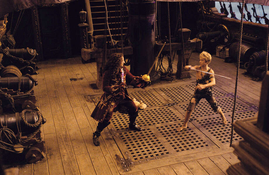 Captain Hook (Jason Isaacs) and Peter Pan (Jeremy  Sumpter) in 2003's Peter Pan. Photo: Getty / Universal Studios