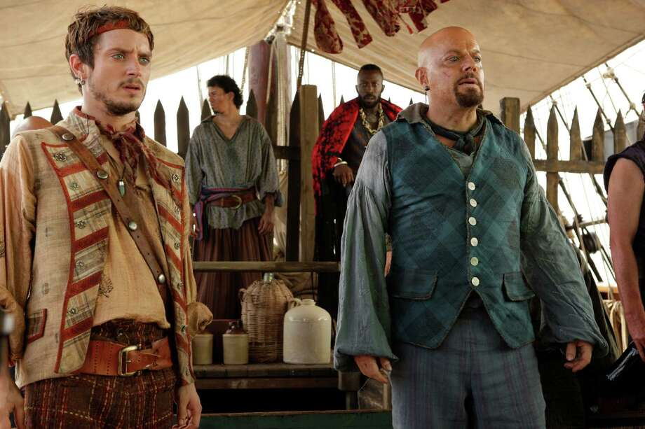 Treasure Island (2012), a Syfy Channel Original Movie. Pictured: (left-right) Elijah Wood as Ben Gunn, Eddie Izzard as Long John Silver.  Photo: Syfy, Getty / 2012 Syfy Media, LLC