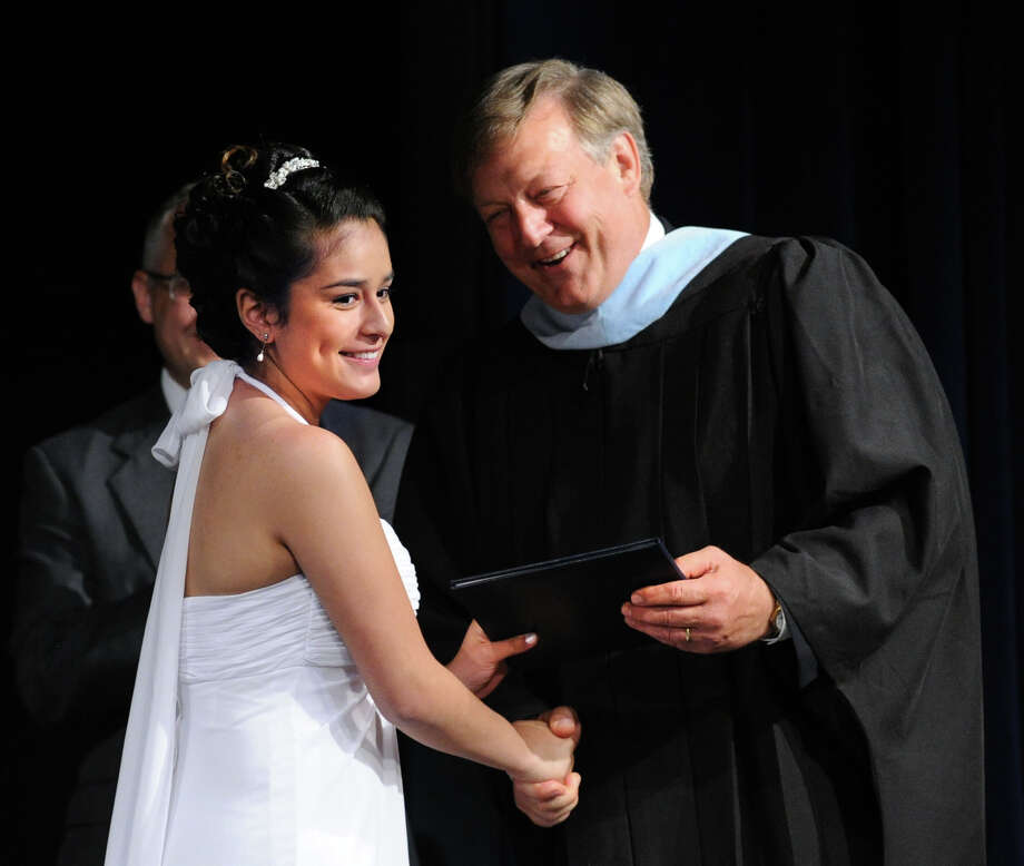 Katherine Medina, left, receives her Stanwich School diploma from Head of the School, Paul Geise, during the Stanwich School First Commencement at the school in Greenwich, Thursday, May 29, 2014. Sixteen students graduated from the school as the first class. Photo: Bob Luckey / Greenwich Time