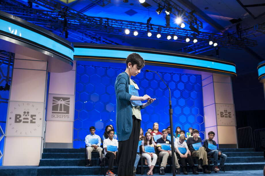 Lydia Loverin, 12, of Pittsfield, Massachusetts, participates in the semifinals of the Scripps National Spelling Bee on May 29, 2014 at the Gaylord National Resort and Convention Center in National Harbor, Maryland.   times union Photo: Pete Marovich / Pete Marovich Images