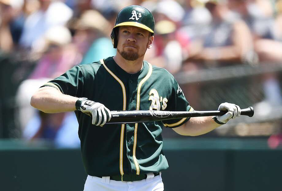 Brandon Moss reacts after his popup in the fifth inning kept Coco Crisp on third. Crisp didn't score in the inning. Photo: Thearon W. Henderson, Getty Images