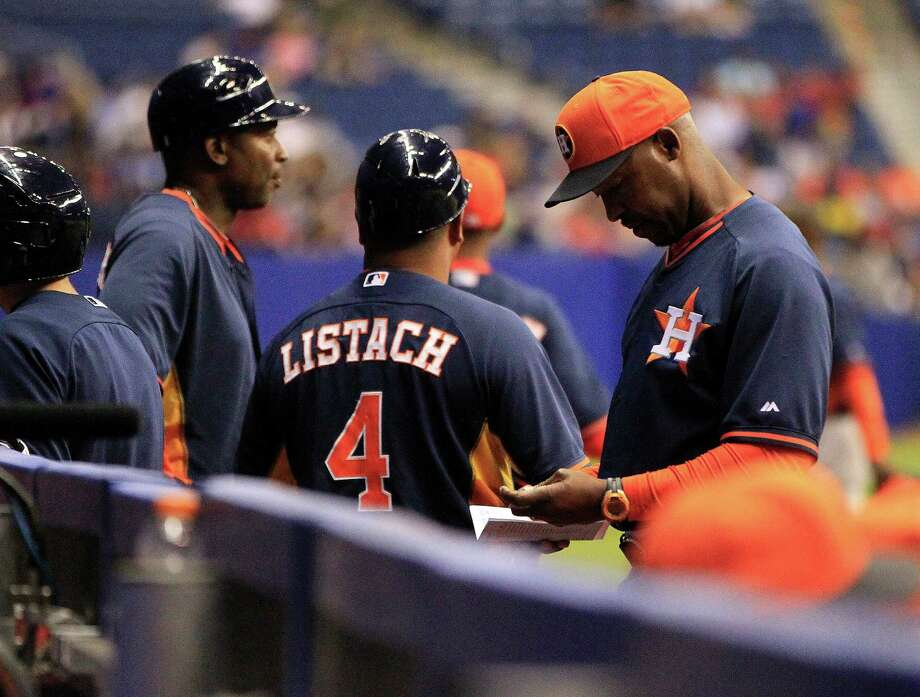 The Astros' staff is an example of the diversity that was missing from major league baseball well into the 1900s as manager Bo Porter, right, has Tarrik Brock, left, and Pat Listach among his coaches. Photo: Karen Warren, Staff / © 2014 Houston Chronicle