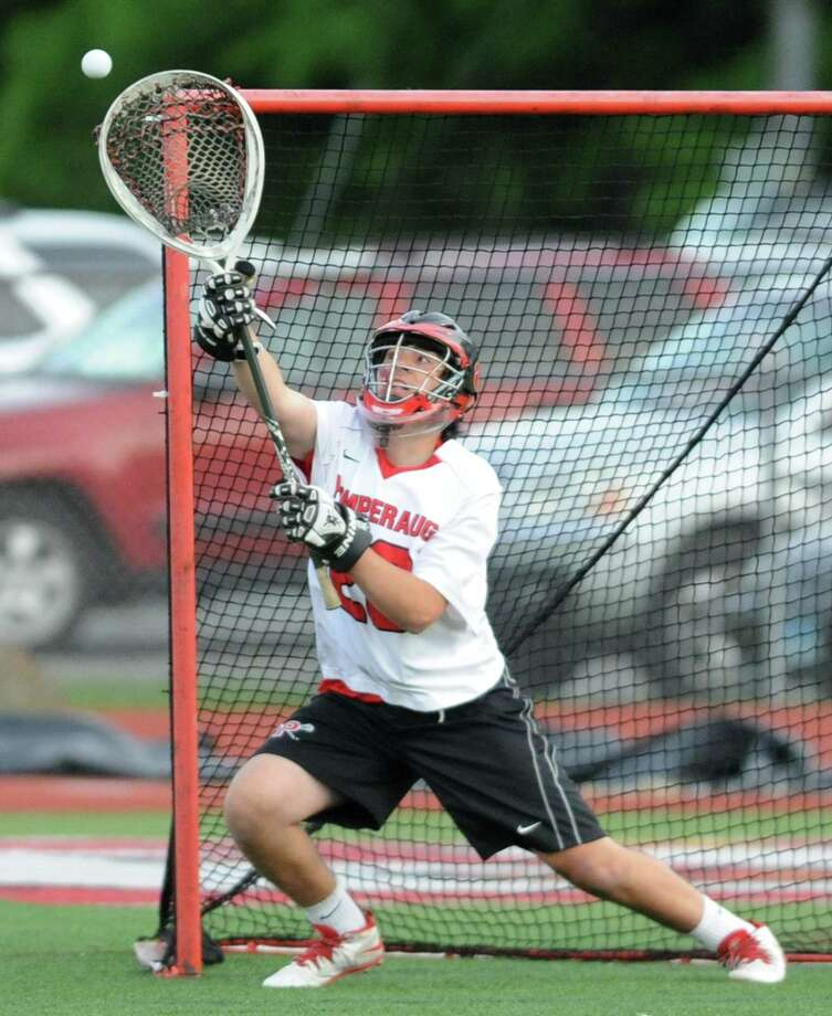Pomperaug goalie Tyler Nevers makes a save in Pomperaug's 15-3 win over Notre Dame Fairfield the high school boys lacrosse SWC Division II semifinal game at Pomperaug High School in Southbury, Conn. Thursday, May 29, 2014. Photo: Tyler Sizemore / The News-Times