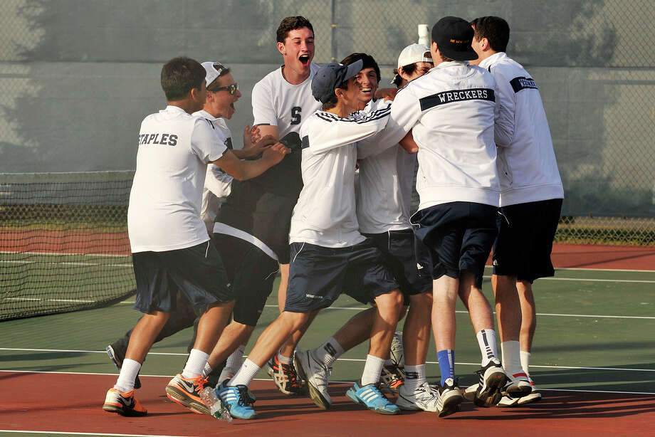 The Staples boys tennis team surrounds Baxter Stein and Connor Mitnick solidifying their FCIAC championship tennis match against Ridgefield at Wilton High School in Wilton, Conn., on Thursday, May 29, 2014. Staples won, 4-3. Photo: Jason Rearick / Stamford Advocate