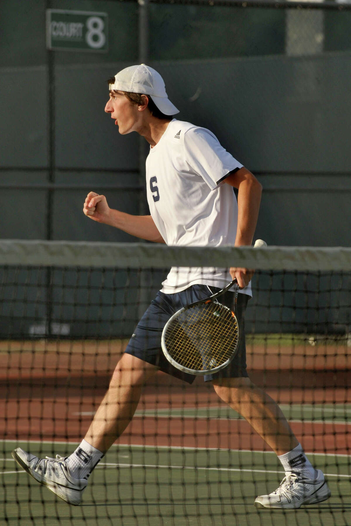 Staples' Connor Mitnick celebrates after beating Ridgefield's Tal Nizan and Ryan Brucato during their FCIAC championship doubles tennis match at Wilton High School in Wilton, Conn., on Thursday, May 29, 2014. Staples won, 4-3.