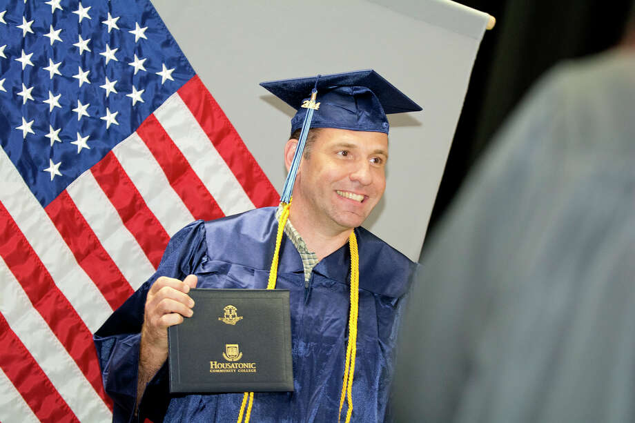 U.S. Air Force Veteran, Timothy Virkler, proudly holds up his diploma in Aviation Maintenance during Housatonic Community College's 47th commencement at Webster Bank Arena in Bridgeport on May 29, 2014. Photo: Amy Mortensen / Connecticut Post Freelance