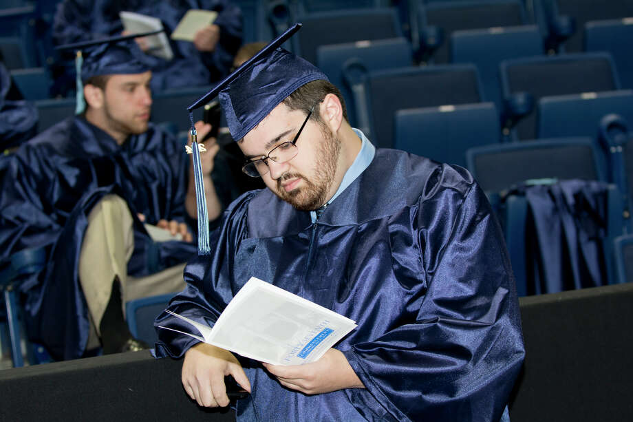 Graduate Samuel Rosoff, of Bridgeport, enjoys a quiet moment backstage during Housatonic Community College's 47th commencement at Webster Bank Arena in Bridgeport on May 29, 2014. Photo: Amy Mortensen / Connecticut Post Freelance