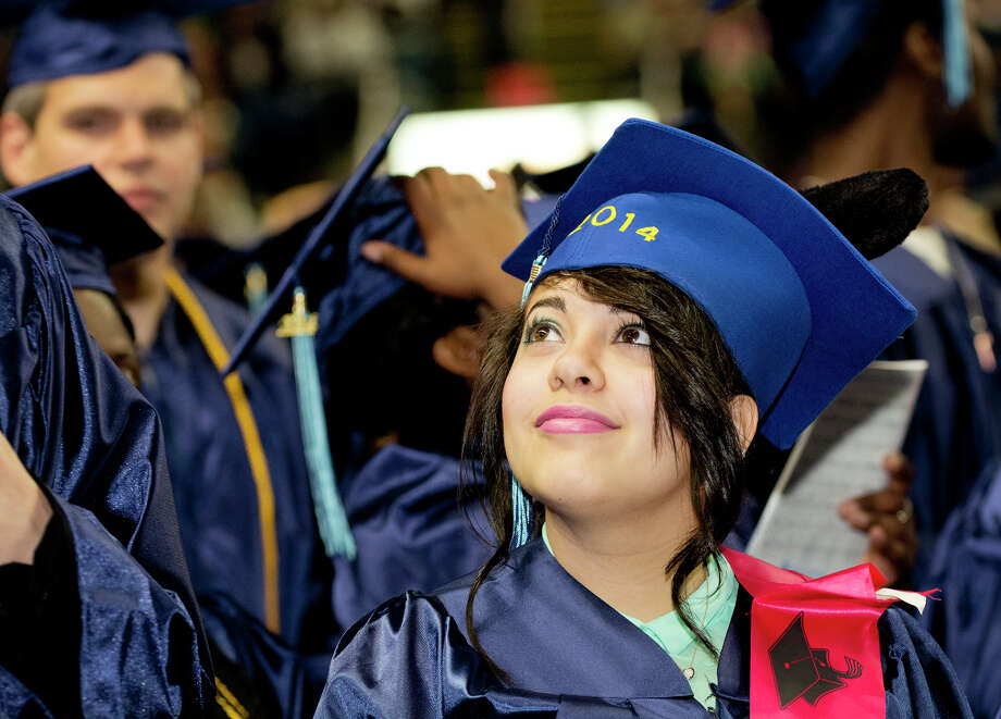 Graduate Bianca Alejos glances up in the stands during Housatonic Community College's 47th commencement at Webster Bank Arena in Bridgeport on May 29, 2014. Photo: Amy Mortensen / Connecticut Post Freelance