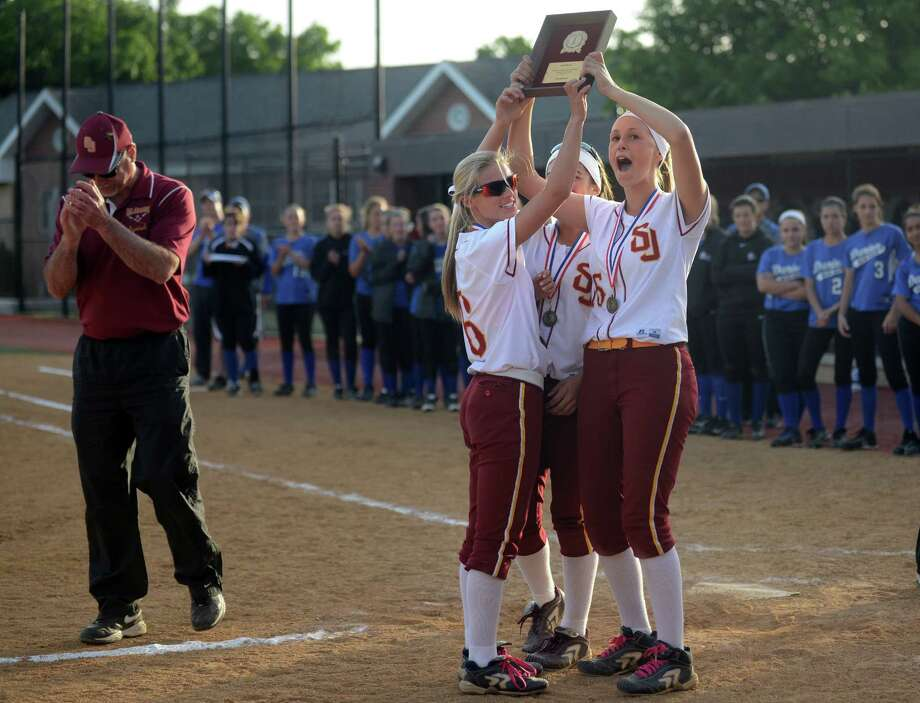 St. Joseph captains Samantha Errico, Mickaela Mallozzi and Victoria Ceballos hold up the team's trophy following their FCIAC Softball championship game win over Darien Thursday, May 29, 2014, at Sacred Heart University in Fairfield, Conn. Photo: Autumn Driscoll / Connecticut Post
