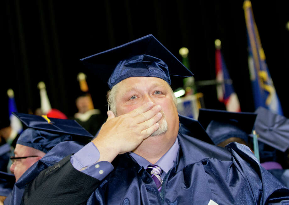 Graduate and U.S. Veteran Chet Daniels, of Stratford, blows a kiss to his family in the stands during Housatonic Community College's 47th commencement at Webster Bank Arena in Bridgeport on May 29, 2014. Photo: Amy Mortensen / Connecticut Post Freelance