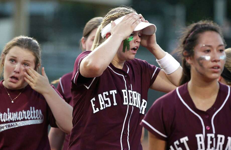 East Bernard's Samantha Show, middle, reacts after losing the 2A state softball championship game 5-3 to Crawford at McCombs Field on Thursday, May 29, 2014, in Austin. Photo: J. Patric Schneider, For The Chronicle / © 2014 Houston Chronicle
