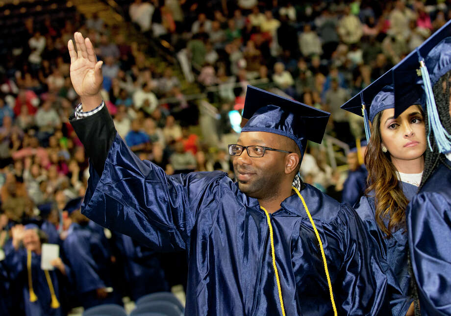 Graduate Douglas Thomas, of Fairfield, waves to friends and family during Housatonic Community College's 47th commencement at Webster Bank Arena in Bridgeport on May 29, 2014. Photo: Amy Mortensen / Connecticut Post Freelance