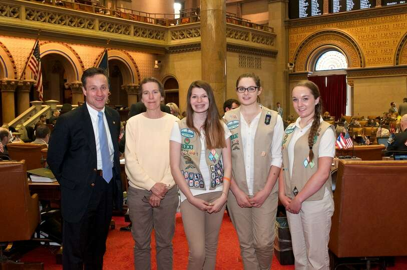 From left to right: Assemblyman Pete Lopez, Girl Scout Leader Linda Stephen,  and members Emily Kaar