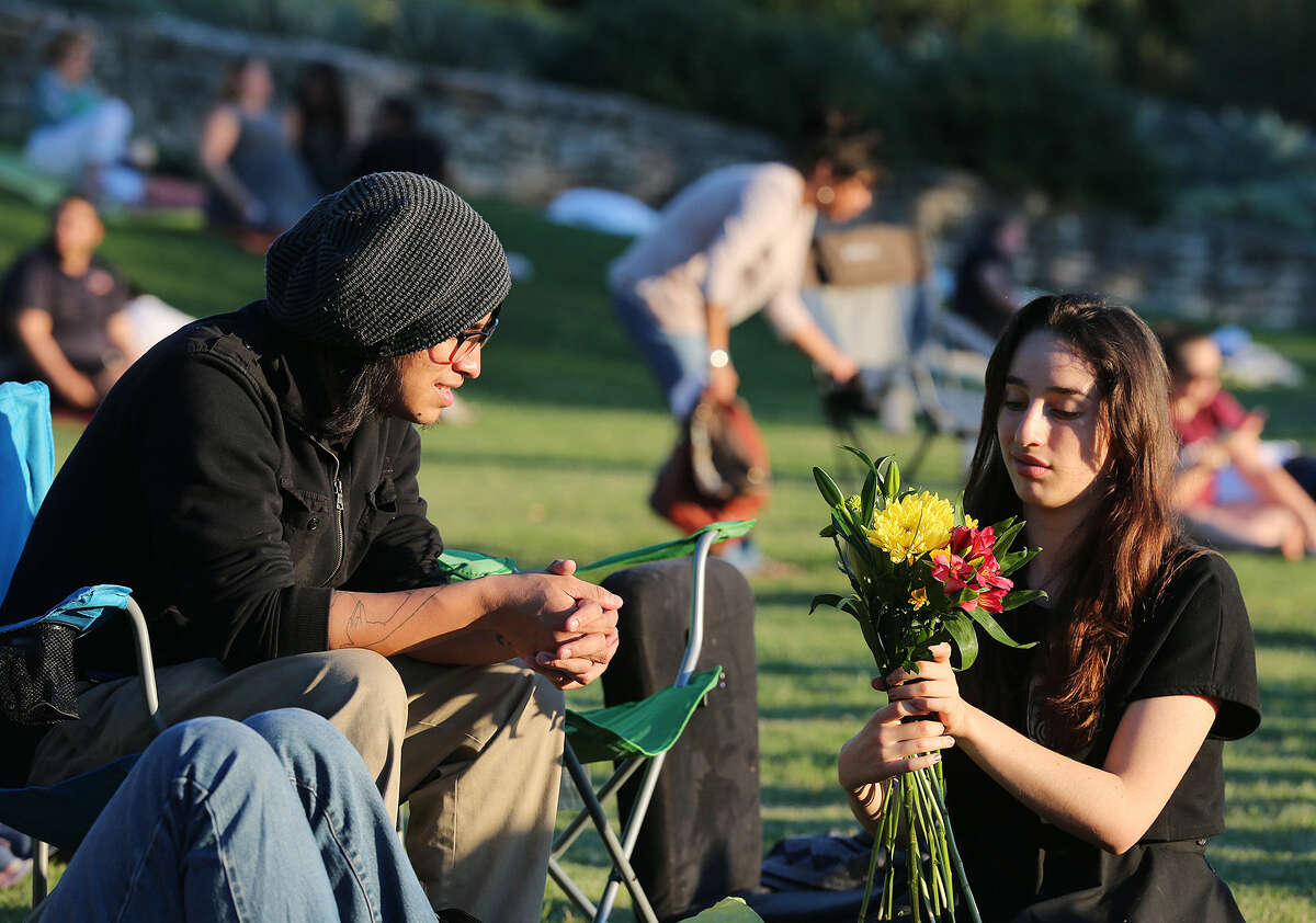 Benjamin Garcez (left) and Elda Flores arrange flowers for the actors before the start of Shakespeare in the Park's