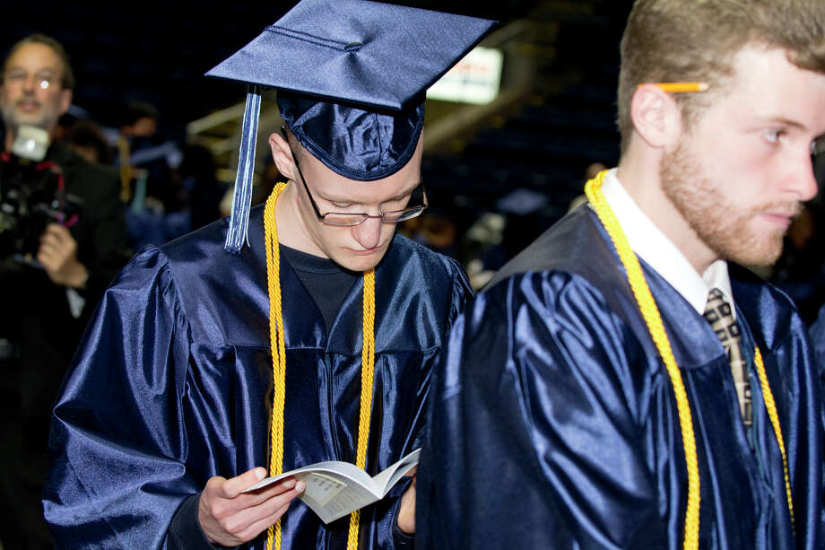 Graduate Dominick Jurkowski lines up backstage during Housatonic Community College's 47th commencement at Webster Bank Arena in Bridgeport on May 29, 2014. Photo: Amy Mortensen / Connecticut Post Freelance