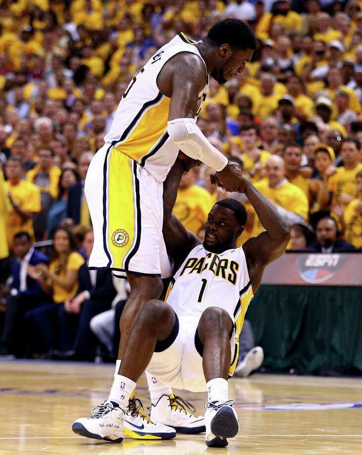 """Pacers guard Lance Stephenson, being helped up by Roy Hibbert, said he was """"having fun and enjoying the moment"""" by trying to pester the Heat. Photo: Andy Lyons / Getty Images / 2014 Getty Images"""