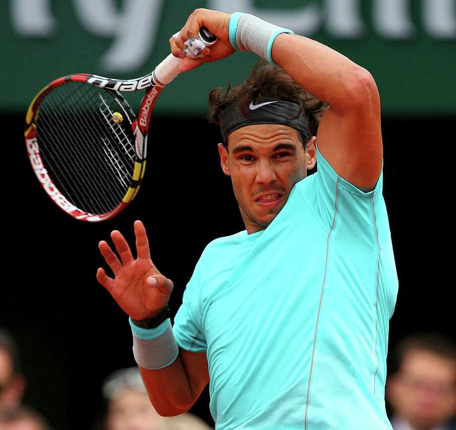 Rafael Nadal returns a shot during his 6-2, 6-2, 6-3 victory over Dominic Thiem in the second round of the French Open at Roland Garros in Paris. Photo: Clive Brunskill / Getty Images / 2014 Getty Images