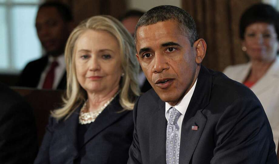 "Hillary Clinton, shown in a Cabinet meeting with President Barack Obama in 2012, is gearing up for the release of her memoir ""Hard Choices"" on June 10. Photo: Associated Press / AP"